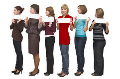 One stand out against six women Royalty Free Stock Image