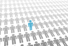 One stand up person in world of lay down people Royalty Free Stock Photo