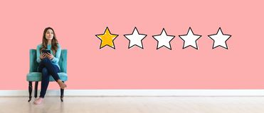 One star rating with young woman royalty free stock photo