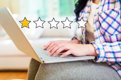 One Star Rating with woman using a laptop stock photo