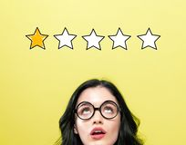 One star rating with young woman stock photography