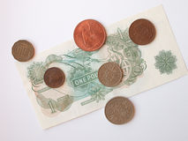 One Sterling Pound note, circa 1970, and coins Stock Photos