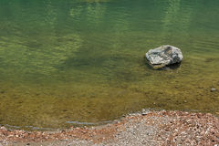 One stone in a river in nobody outdoors Stock Photography