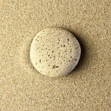 One stone in the sand. In golden colors Royalty Free Stock Image