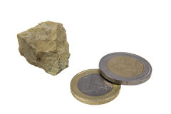 One stone and two coins Royalty Free Stock Image
