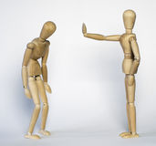Two wooden mannequin. One is stoping the other who gets sad Royalty Free Stock Photo