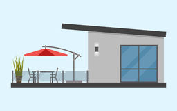One-storey house with a terrace and a table and chairs and a sun. Ny red umbrella. Simple. Flat. . Material design. Vector illustration. Light background. Eps10 Stock Photography