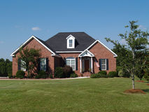 One story brick residential home. One story new brick residential home Royalty Free Stock Images