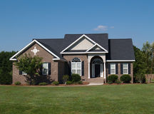One story brick residential home. One story new brown brick residential home Stock Images