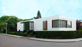 One Story Home Netherlands. A one story home in the Netherlands with neatly groomed shrubbery, detailed windows and a modern porch Royalty Free Stock Images