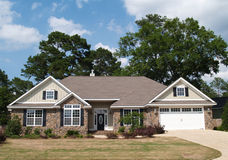 One Story Residential Home. With both stone and board siding on the facade Stock Photos