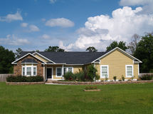 One Story Residential Home. With vinyl siding and brick or stone on the facade Stock Photo