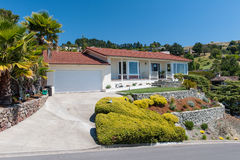 One story single family house with driveway royalty free stock photography