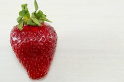 One strawberry on white background Royalty Free Stock Photography