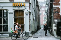 One of the street in Amsterdam. There is a cycling people in street Stock Photos
