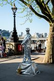 One of the street dressed up performers near Jubilee gardens and London Eye observation wheel. England Stock Photography