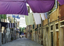 One street in Venice. Back street in Venice with colourful clothes hanged out to dry Royalty Free Stock Photography