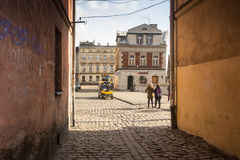 One of the streets in historical center of Krakow. Stock Photos