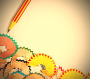 One striped pencil for drawing and shavings Royalty Free Stock Image