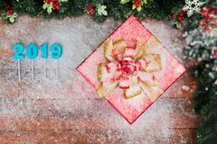 Christmas and new year concept have year 2019 blue color border design, copy space bottom left, decorating with red gift boxes and royalty free stock image