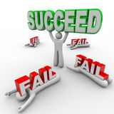One Successful Person Holds Succeed Word Others Fail. One person succeeds and holds the word Succeed while others lay crushed under the word Fail, symbolizing vector illustration