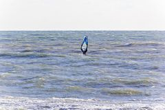 One surfer in open choppy sea Royalty Free Stock Photography