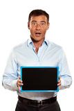 One surprised man holding a blackboard Royalty Free Stock Photos