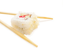 One sushi roll with chopsticks over white Stock Images
