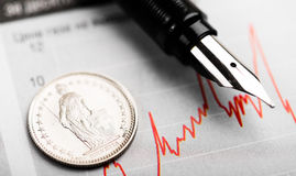 One Swiss Franc coin on fluctuating graph. Stock Images