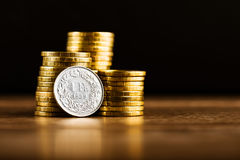One swiss frank coin and gold money Stock Photos