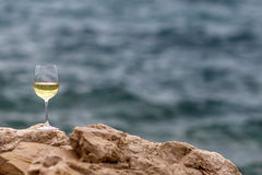 One tall wine glass Stock Images