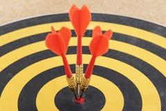 One target with three dart arrows hitting the bullseye Royalty Free Stock Photo