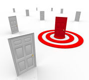 One Targeted Door Address in Bulls-Eye Target. One door is red in the middle of a target bullseye, representing a customer that has been selected for advertising Stock Image