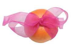 One tasty orange. And pink bow Royalty Free Stock Image