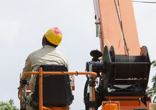 One technician is controlling bucket to high up electrician work Royalty Free Stock Photos