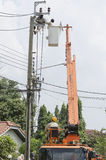 One technician is controlling bucket to high up electrician work Stock Images