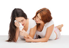 One teenage girl comforting another after break up. Friendship and happy people concept - one teenage girl comforting another after break up Royalty Free Stock Photo