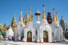 One of the temples of the Shwedagon pagoda on a sunny day. Yangon, Myanmar Royalty Free Stock Images