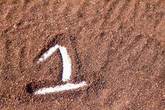 One text shape on cocoa powder, white background Stock Image