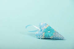 One textile heart with flower on blue background Royalty Free Stock Photos