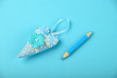 One textile heart with pencil on blue background Royalty Free Stock Images