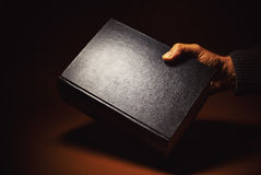 One Thick Book in a Hand Stock Photography