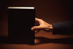 One Thick Book in a Hand Royalty Free Stock Images