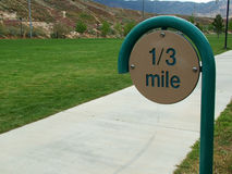 One Third Mile. Marker on park exercise path royalty free stock photos