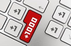One Thousand +. Social media concept on modern aluminium keyboard Stock Photo