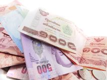 One thousand on pile of banknotes, thai money stock photography