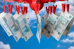 One thousand rubles banknotes on the clothes-peg. Against the blue sky. Money laundering concept Stock Photo