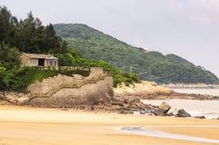 One thousand step beach building Putuoshan. A small building and gazebo on one thousand step beach on the island of Putuoshan China, in Zhejiang Province Stock Image