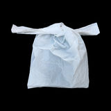 one tied white plastic bag isolated on black Stock Photo