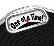 One at a Time Words Scale Overweight Fat Obesity Scolding. One at a Time words on a scale display scolding you that you weigh too much, are obese, fat or Stock Photos